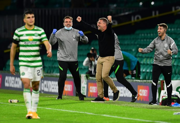 GLASGOW, SCOTLAND - AUGUST 26: Serhiy Rebrov, Manager of Ferencvaros (L2), celebrates on the side line at the full time whistle during the UEFA Champions League second qualifying round match between Celtic and Ferencvaros at Celtic Park on August 26, 2020 in Glasgow, Scotland. (Photo by Mark Runnacles/Getty Images)
