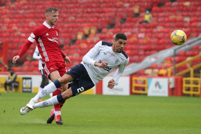 Aberdeen's Bruce Anderson (L) vies with Rangers' Leon Balogun during the Scottish Premier League football match between Aberdeen and Rangers at Pittodrie Stadium in Aberdeen, northeast Scotland, on August 1, 2020. (Photo by Andrew Milligan / POOL / AFP) (Photo by ANDREW MILLIGAN/POOL/AFP via Getty Images)
