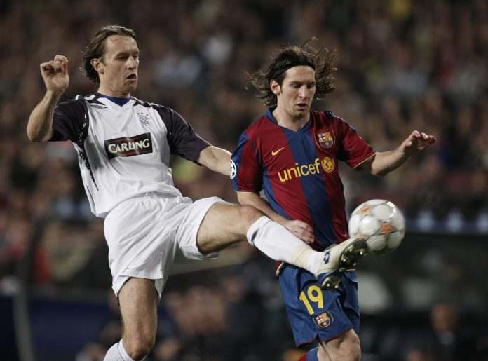 BARCELONA, SPAIN - NOVEMBER 07: Sasa Papac (L) of Rangers takes the ball from Lionel Messi of Barcelona during the UEFA Champions League Group E match between Barcelona and Rangers at the Camp Nou stadium on November , 7, 2007 in Barcelona, Spain.