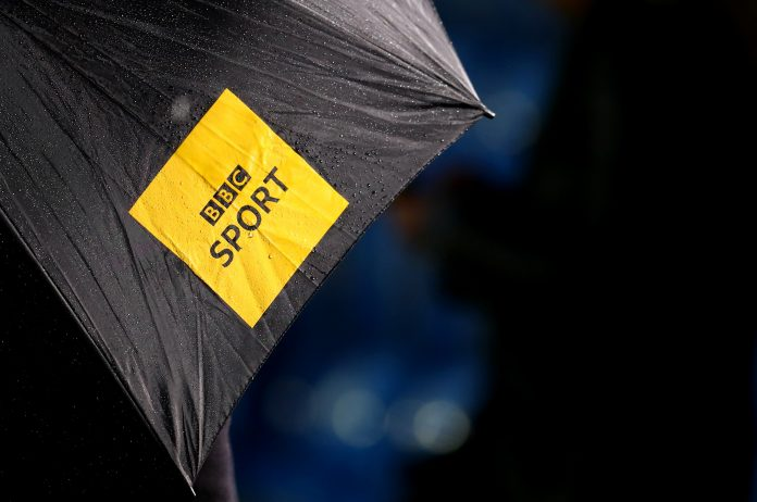 SOLIHULL, ENGLAND - SEPTEMBER 30: The BBC sport television logo on an umbrella during the Vitality Women's FA Cup Semi Final match between Birmingham City and Everton on September 30, 2020 in Solihull, England. Sporting stadiums around the UK remain under strict restrictions due to the Coronavirus Pandemic as Government social distancing laws prohibit fans inside venues resulting in games being played behind closed doors.