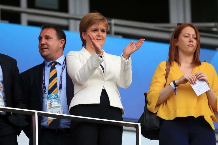 NICE, FRANCE - JUNE 09: Nicola Sturgeon, First Minister of Scotland looks on from the stands prior to the 2019 FIFA Women's World Cup France group D match between England and Scotland at Stade de Nice on June 09, 2019 in Nice, France.