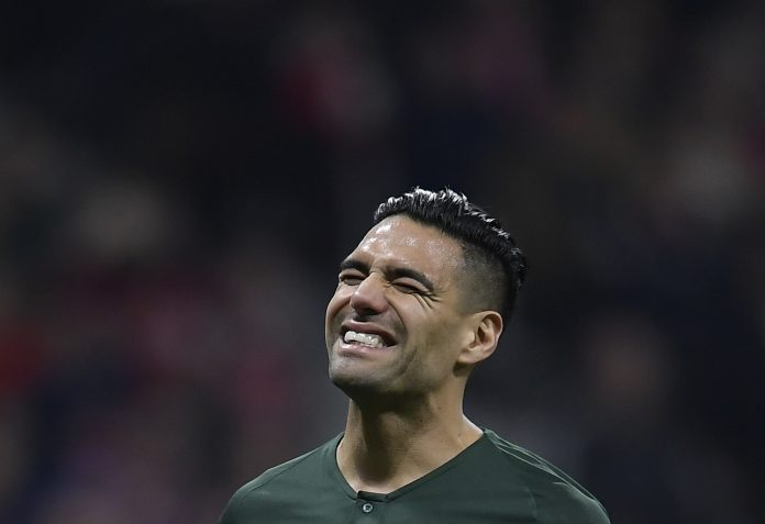 Monaco's Colombian forward Radamel Falcao reacts after missing a penalty kick during the UEFA Champions League group A football match between Atletico Madrid and Monaco at the Wanda Metropolitan stadium in Madrid on November 28, 2018. (Photo by OSCAR DEL POZO / AFP)
