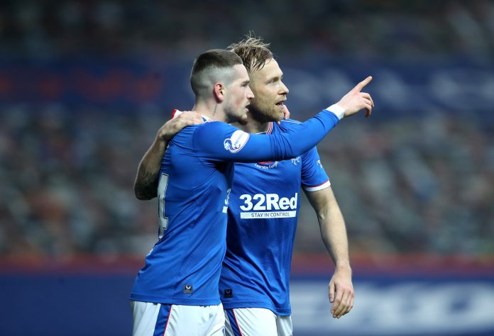 GLASGOW, SCOTLAND - NOVEMBER 08: Scott Arfield of Rangers celebrates with teammate Ryan Kent after scoring his team's first goal during the Ladbrokes Scottish Premiership match between Rangers and Hamilton Academical at Ibrox Stadium on November 08, 2020 in Glasgow, Scotland. Sporting stadiums around the UK remain under strict restrictions due to the Coronavirus Pandemic as Government social distancing laws prohibit fans inside venues resulting in games being played behind closed doors.