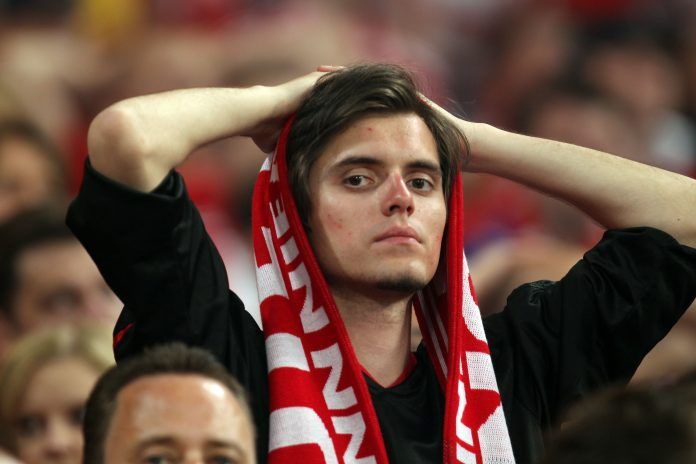 MADRID, SPAIN - MAY 22: A Bayern Muenchen fan looks dejected after their team's defeat at the end of the UEFA Champions League Final match between FC Bayern Muenchen and Inter Milan at the Estadio Santiago Bernabeu on May 22, 2010 in Madrid, Spain.