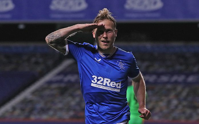 GLASGOW, SCOTLAND - OCTOBER 01: Scott Arfield of Rangers celebrates after scoring his team's first goal during the UEFA Europa League play-off match between Rangers and Galatasaray at Ibrox Stadium on October 01, 2020 in Glasgow, Scotland. Football Stadiums around Europe remain empty due to the Coronavirus Pandemic as Government social distancing laws prohibit fans inside venues resulting in fixtures being played behind closed doors.